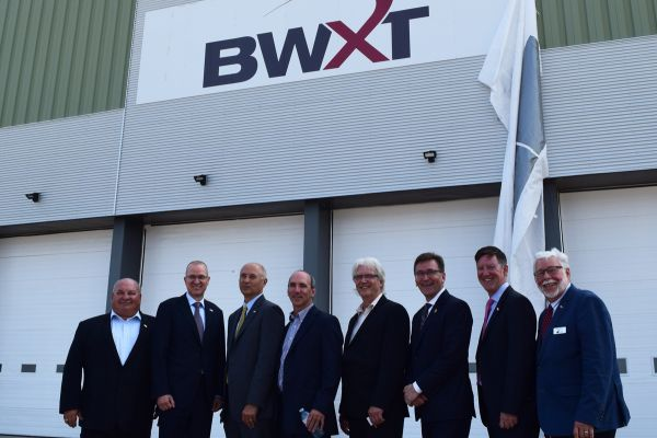 Warden Halliday stands with Mayor Boddy, MP Miller, MPP Walker and delegates from Bruce Power, BWXT and Brotech,