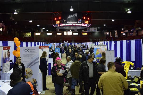 Photo of job seekers and businesses on the arena floor at the 2019 regional job fair